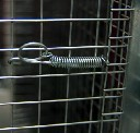 Sprężyna z haczykiem do zamknięć klatek długość 65mm - zdjecie 2